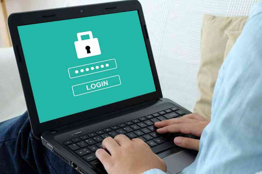 Man typing password on labtop screen background, cyber security